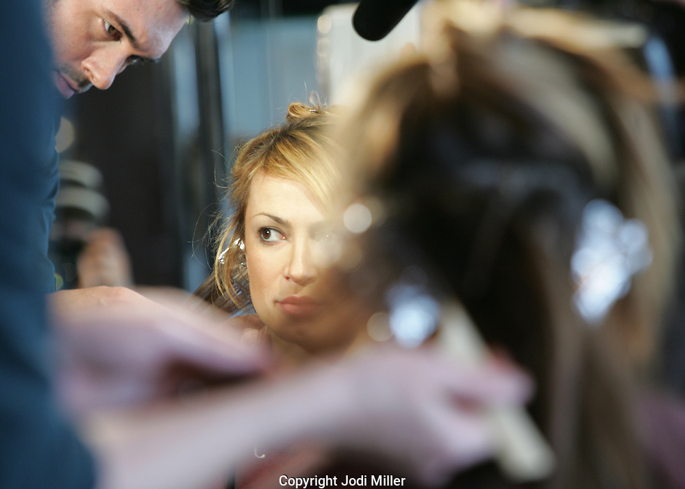 Dancing with the Star's Karina Smirnof sits while Jacob Neal Salon senior stylist Drew Grudowski applies color during a recent makeover at Neal's Columbus Salon.(Jodi Miller/Alive)(Jodi Miller/Alive)