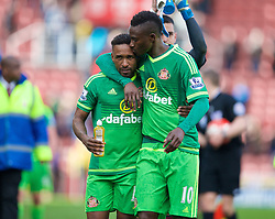 STOKE-ON-TRENT, ENGLAND - Saturday, April 30, 2016: Sunderland's Dame N'Doye kisses goal-scorer Jermain Defoe after a late 1-1 draw against Stoke City during the FA Premier League match at the Britannia Stadium. (Pic by David Rawcliffe/Propaganda)