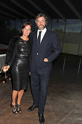 The EARL OF ALBEMARLE and DANIELA AGNELLI at a dinner hosted by Calvin Klein Collection to celebrate the future Home of The Design Museum at The Commonwealth Institute, Kensington, London on 13th October 2011.