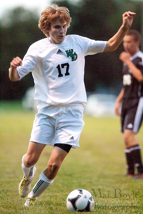 West Deptford's Evan Fahey beings the ball downfield during a home game against Haddonfield on Monday September 19, 2011.