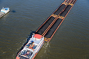 Nederland, Gelderland, Gemeente Tiel, 24-10-2013; duwboot Veerhaven X – Orka duwt zes duwbakken met erts en kolen op de Waal ter hoogte van Tiel.<br /> Pusher (tug) Veerhaven X - Orca pushing six barges with ore and coal on the Waal near Tiel.<br /> luchtfoto (toeslag op standaard tarieven);<br /> aerial photo (additional fee required);<br /> copyright foto/photo Siebe Swart.