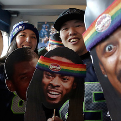 Seattle Seahawks fans hold up cutouts of Seahawks players as they watch Super Bowl XLVIII at the Hawk's Nest bar in Seattle, Washington February 2, 2014. The Seahawks meet the Denver Broncos for the big game Sunday in East Rutherford, New Jersey.  REUTERS/Jason Redmond  (UNITED STATES)