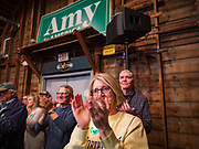 02 JANUARY 2020 - JOHNSTON, IOWA: People applaud for Senator Amy Klobuchar (D-MN) during a campaign event in the Simpson Barn, an event space in Johnston, a suburb of Des Moines. More than 500 people attended the event, the largest crowd to attend a Klobuchar event so far. Sen. Klobuchar is campaigning to be the Democratic nominee for the US Presidency. Iowa holds the first selection event of the Presidential election cycle. The Iowa caucuses are Feb. 3, 2020.         PHOTO BY JACK KURTZ