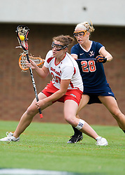 Maryland Terrapins Attack Lauren Cohen (32) is defended by Virginia Cavaliers A Megan O'Malley (28).  The #3 ranked Virginia Cavaliers defeated the #2 ranked Maryland Terrapins 10-9 in overtime in the finals of the Women's 2008 Atlantic Coast Conference Lacrosse tournament at the University of Virginia's Scott Stadium in Charlottesville, VA on April 27, 2008.