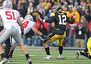 November 20 2010: Iowa Hawkeyes quarterback Ricky Stanzi (12) steps up to avoid Ohio State Buckeyes defensive lineman John Simon (54) during the first quarter of the NCAA football game between the Ohio State Buckeyes and the Iowa Hawkeyes at Kinnick Stadium in Iowa City, Iowa on Saturday November 20, 2010. Ohio State defeated Iowa 20-17.