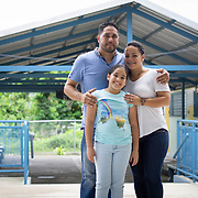 JULY 20, 2018---YABUCOA, PUERTO RICO----<br /> Alejandra Sof&iacute;a Laboy Marrero, 9, with her parents Juan  Laboy, 40, and  Yelixa Marrero 40 in the Marta Sanchez Alverio school in Yabucoa . Alejandra had moved to Central Florida following the path of Hurricane Maria through Puerto Rico, but was not happy away from her hometown.<br /> (Photo by Angel Valentin/Freelance)