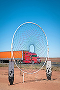 A big rig drives behind a larger than life dream catcher along the Arizona portion of Route 66. Missoula Photographer