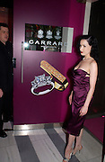 Dita von Teese, Garrard 1st Anniversary party for their new shop, Albermarle St. 21 September 2003. © Copyright Photograph by Dafydd Jones 66 Stockwell Park Rd. London SW9 0DA Tel 020 7733 0108 www.dafjones.com