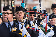 A pipe band marches along Piccadilly during the St Patrick's Day Parade in Westminster, London.<br /> Picture by Paul Davey/Focus Images Ltd +447966 016296<br /> 13/03/2016