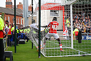 Port Vale's Jordan Slew hits the back of the net trying to retrieve the ball after scoring his teams 1st goal. Skybet football league one match, Crewe Alexandra v Port Vale at the Alexandra Stadium in Crewe on Saturday 13th Sept 2014.<br /> pic by Chris Stading, Andrew Orchard sports photography.