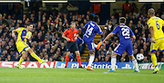 Eitan Tibi lets fly from just outside the box during the Champions League match between Chelsea and Maccabi Tel Aviv at Stamford Bridge, London, England on 16 September 2015. Photo by Andy Walter.
