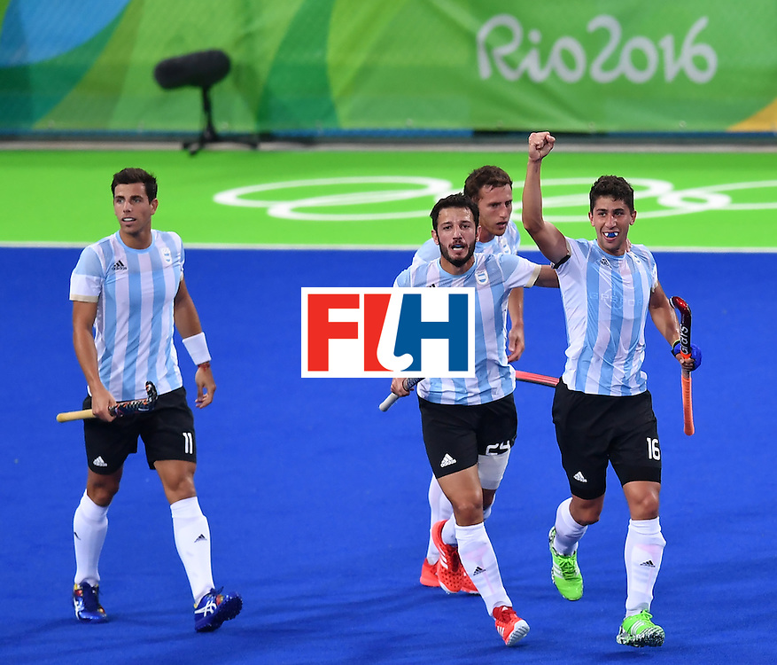 Argentina's Ignacio Ortiz (R) celebrates a goal with teammates during the men's Gold medal field hockey Belgium vs Argentina match of the Rio 2016 Olympics Games at the Olympic Hockey Centre in Rio de Janeiro on August 18, 2016. / AFP / MANAN VATSYAYANA        (Photo credit should read MANAN VATSYAYANA/AFP/Getty Images)