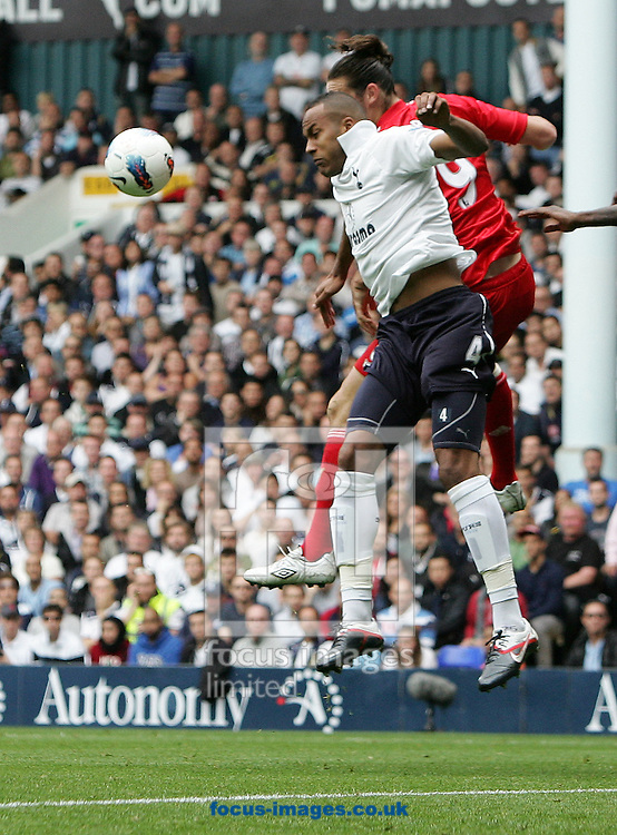 Picture by Paul Terry/Focus Images Ltd..18/9/11.Younes Kaboul of Tottenham and Andy Carroll of Liverpool during the Barclays Premier League match at White Hart Lane stadium, London.