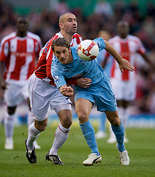 STOKE, ENGLAND - Sunday, October 19, 2008: Tottenham Hotspur's David Bentley and Stoke City's Danny Higgingbotham during the Premiership match at the Britannia Stadium. (Photo by David Rawcliffe/Propaganda)