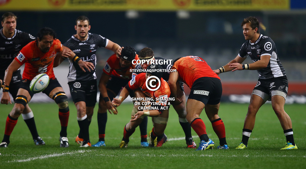 DURBAN, SOUTH AFRICA - JULY 15: Taiyo Ando of the Sunwolves gets his pass away during the Super Rugby match between the Cell C Sharks and Sunwolves at Growthpoint Kings Park on July 15, 2016 in Durban, South Africa. (Photo by Steve Haag/Gallo Images)