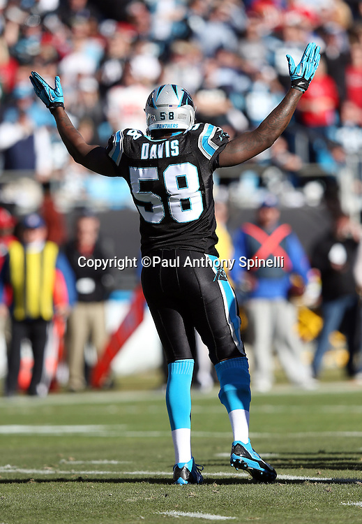 Carolina Panthers outside linebacker Thomas Davis (58) waves his arms to fire up the fans during the NFC Divisional Playoff NFL football game against the San Francisco 49ers on Sunday, Jan. 12, 2014 in Charlotte, N.C. The 49ers won the game 23-10. ©Paul Anthony Spinelli