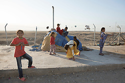 Licensed to London News Pictures. 22/10/2016. Young Iraqi refugees play in a corner of the Dibaga refugee camp near Makhmur, Iraq.<br />