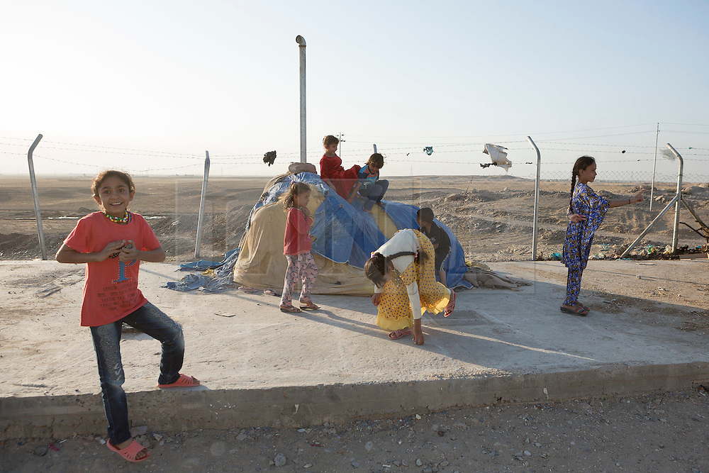 Licensed to London News Pictures. 22/10/2016. Young Iraqi refugees play in a corner of the Dibaga refugee camp near Makhmur, Iraq.<br /> <br /> The crowded Dibaga camp, housing around 28,000 Sunni Arab refugees, is the main gathering point for new IDPs now fleeing areas where ISIS have been pushed out or are in conflict with the Iraqi Army. Photo credit: Matt Cetti-Roberts/LNP
