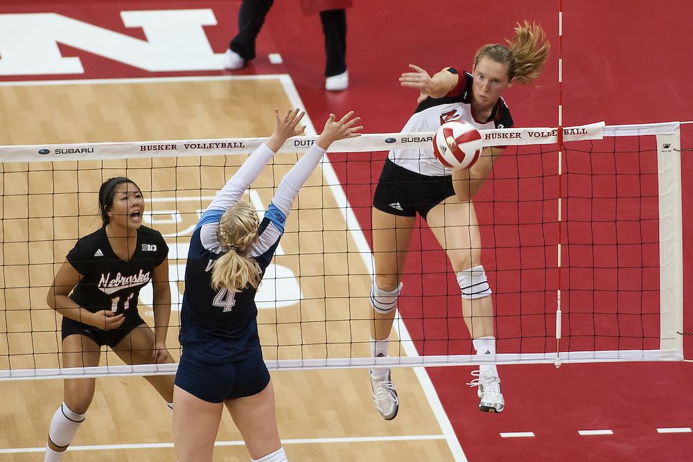 September 6, 2013: Kadie Rolfzen #6 of the Nebraska Cornhuskers spikes one down the sideline against Emma Pettit #4 of the Villanova Wildcats at the Devaney Sports Center in Lincoln, Nebraska. Nebraska defeated Villanova three sets to one.