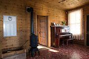 The original Cash family piano stands in the living room of the boyhood home of musician Johnny Cash on Saturday, August 16, 2014, in Dyess, Ark. The home was restored to it's appearance when the Cash family lived in it, from 1935-1954, and was part of The Dyess Colony that was created in 1934 as part of President Franklin D. Roosevelt's New Deal.<br /> <br /> Photo by Beth Hall