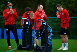 CARDIFF, WALES - Sunday, October 14, 2018: Wales' Connor Roberts takes a drink from a PAS bottle during a training session at the Vale Resort ahead of the UEFA Nations League Group Stage League B Group 4 match between Republic of Ireland and Wales. (Pic by David Rawcliffe/Propaganda)