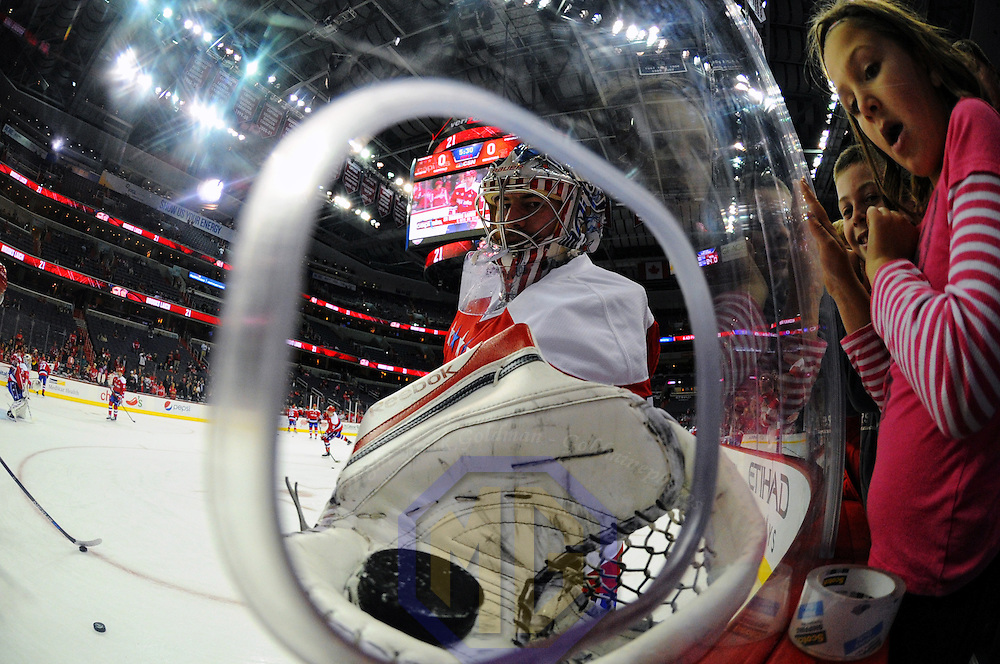16 December 2015:  Washington Capitals goalie Philipp Grubauer (31) hands a puck to Eleanor Rich (8) prior to the game against the Ottawa Senators at the Verizon Center in Washington, D.C. where the Washington Capitals defeated the Ottawa Senators, 2-1.  (Photograph by Mark Goldman - Goldminephotos)