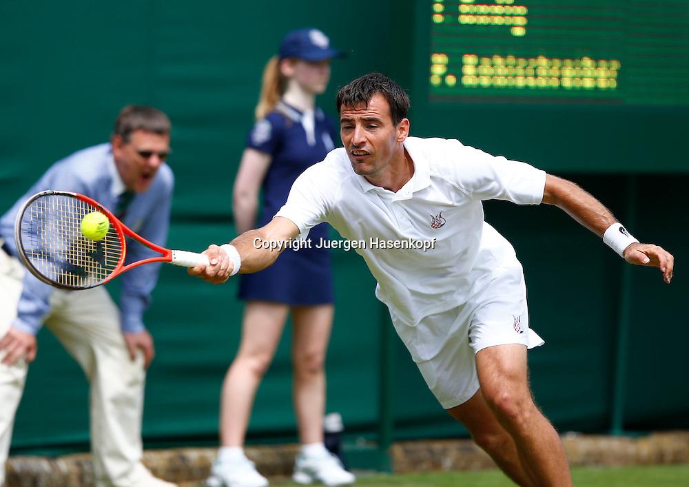 Wimbledon Championships 2013, AELTC,London,<br /> ITF Grand Slam Tennis Tournament,<br /> Ivan Dodig (CRO),Aktion,Einzelbild,Halbkoerper,Querformat,