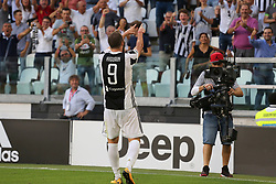 August 19, 2017 - Turin, Piedmont, Italy - Gonzalo Higuain (Juventus FC) celebrates after scoring during the Serie A football match between Juventus FC and Cagliari Calcio at Allianz Stadium on august 19, 2017 in Turin, Italy. (Credit Image: © Massimiliano Ferraro/NurPhoto via ZUMA Press)
