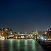 View of bridge over River Siene, Paris, at night.