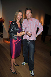 SABRINA GUINNESS and GAWAIN RAINEY at fundraising dinner and auction in aid of Liver Good Life a charity for people with Hepatitis held at Christies, King Street, London on 16th September 2009.