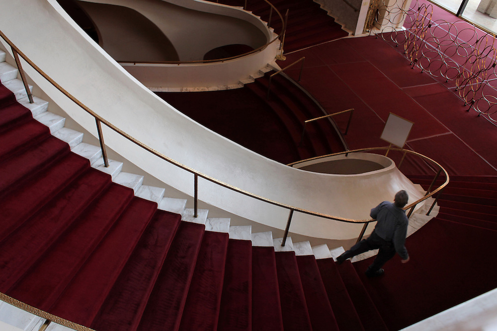 Xavier Mascareñas/The Journal News; James Blumenfeld of Nanuet, who grew up in New City, has been property master at the Metropolitan Opera for 15 years. Blumenfeld walks down a winding staircase in the lobby at the Metropolitan Opera in Lincoln Center in Manhattan on Jan. 27, 2012.