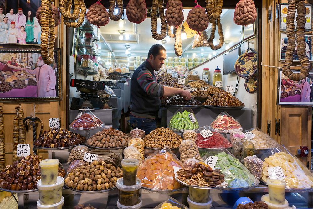FEZ, MOROCCO - 1st FEBRUARY 2018 Market vendor at a dried fruit and nuts market stall in the old Fez Medina, Middle Atlas Mountains, Morocco.