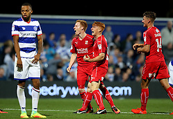 James Brophy of Swindon Town celebrates with Jordan Stewart after scoring a second equalising goal for his side - Mandatory by-line: Robbie Stephenson/JMP - 10/08/2016 - FOOTBALL - Loftus Road - London, England - Queens Park Rangers v Swindon Town - EFL League Cup