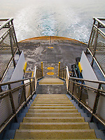 a view looking down a stariway to the car deck on a Washington state ferry in Puget Sound, WA, USA
