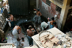 BANGLADESH DHAKA KAWRAN BAZAAR 27FEB05 - Porters take a shower in a secluded bath inside the Kawran Bazaar vegetable market. The Bazaar has been in the Tejgaon area for at least 30 years and is one of the largest markets in Dhaka city...jre/Photo by Jiri Rezac ..© Jiri Rezac 2005..Contact: +44 (0) 7050 110 417.Mobile:  +44 (0) 7801 337 683.Office:  +44 (0) 20 8968 9635..Email:   jiri@jirirezac.com.Web:    www.jirirezac.com..© All images Jiri Rezac 2005- All rights reserved.