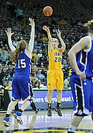 December 20, 2011: Iowa Hawkeyes forward Kelly Krei (20) puts up a shot over Drake Bulldogs forward Rachael Hackbarth (15) during the NCAA women's basketball game between the Drake Bulldogs and the Iowa Hawkeyes at Carver-Hawkeye Arena in Iowa City, Iowa on Tuesday, December 20, 2011. Iowa defeated Drake 71-46.