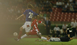 BELGRADE, SERBIA & MONTENEGRO - Wednesday, August 20, 2003: Wales' Robert Earnshaw rounds the Serbia & Montenegro goalkeeper Dragoslav Jervic but sees his shot cleared off the line by Mladen Krstajic during the UEFA European Championship qualifying match at the Red Star Stadium. (Pic by David Rawcliffe/Propaganda)