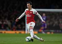 Football - 2018 / 2019 Premier League - Arsenal vs. Newcastle United<br /> <br /> Mesut Ozil (Arsenal FC) glides across the pitch at The Emirates.<br /> <br /> COLORSPORT/DANIEL BEARHAM