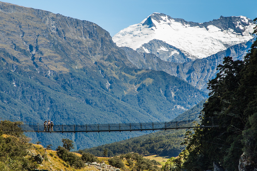 Cindy, Matt and Katrina suffer a pose for me on the suspension bridge crossing the Matukituki River on the Rob Roy Glacier Track.