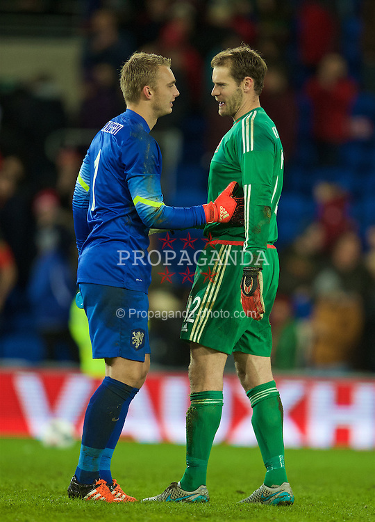 CARDIFF, WALES - Friday, November 13, 2015: Wales' goalkeeper Owain Fon Williams and the Netherlands' goalkeeper Jasper Cillessen after the International Friendly match at the Cardiff City Stadium. (Pic by David Rawcliffe/Propaganda)