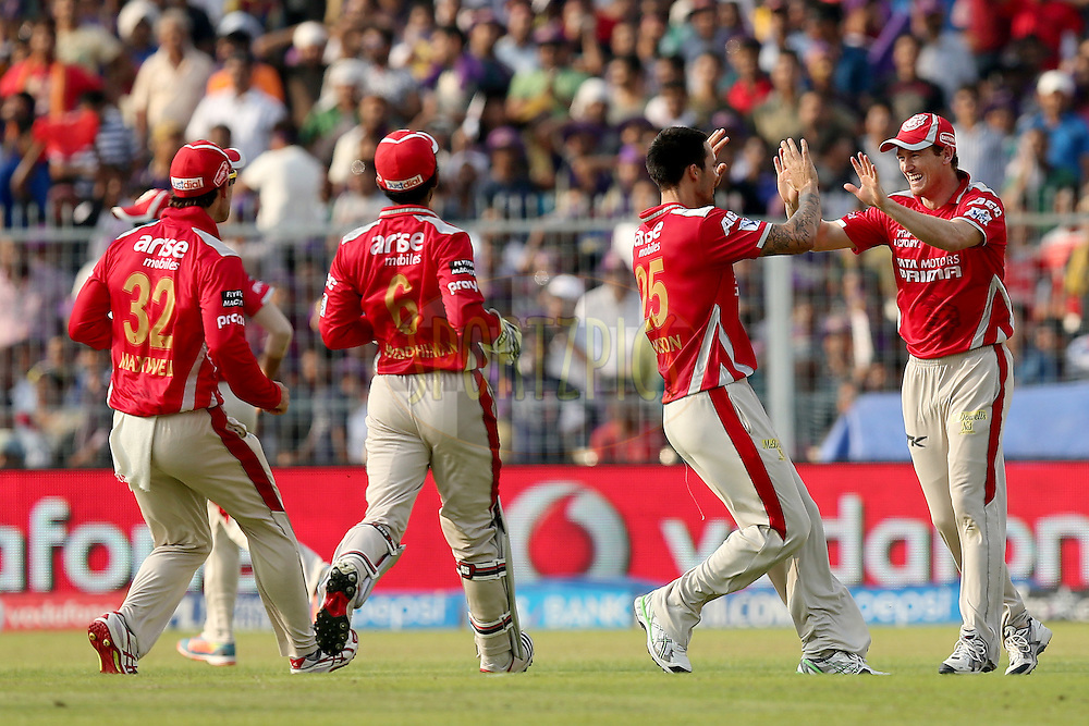 George Bailey and Mitchell Johnson celebrate the wicket of Gautam Gambhir during the first qualifier match (QF1) of the Pepsi Indian Premier League Season VII 2014 between the Kings XI Punjab and the Kolkata Knight Riders held at Eden Gardens Cricket Stadium, Kolkata, India on the 28th May 2014. Photo by Jacques Rossouw / IPL / SPORTZPICS<br /> <br /> <br /> <br /> Image use subject to terms and conditions which can be found here:  http://sportzpics.photoshelter.com/gallery/Pepsi-IPL-Image-terms-and-conditions/G00004VW1IVJ.gB0/C0000TScjhBM6ikg