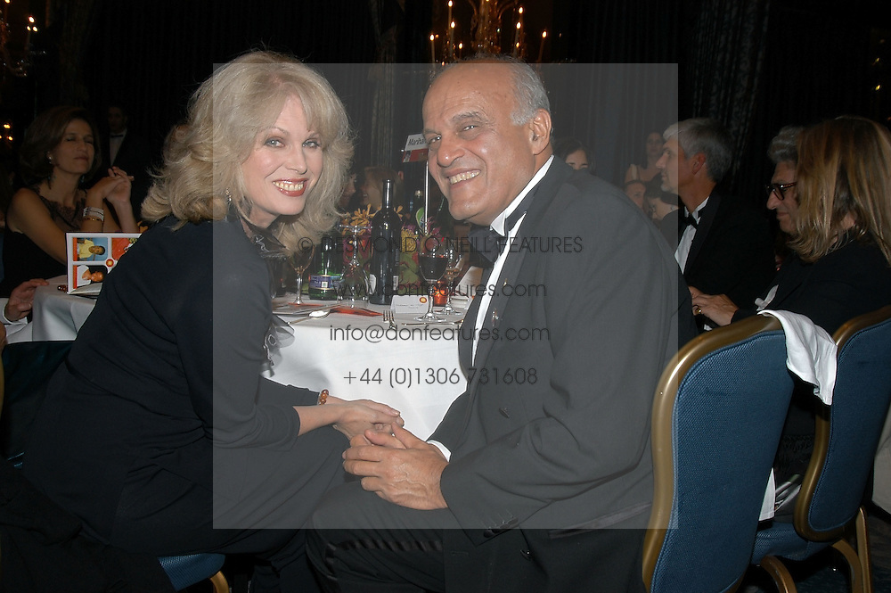 Actress JOANNA LUMLEY and PROF.SIR MAGDI YACOUB at the Chain of Hope Autumn Ball Fiesta held at The Dorchester, Park Lane, London on 6th October 2004.
