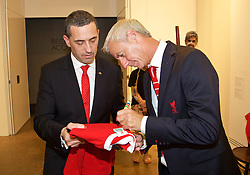 ADELAIDE, AUSTRALIA - Sunday, July 19, 2015: Liverpool's Ian Rush signs a shirt for South Australia's Treasurer Tom Koutsantonis during a visit to the Art Gallery of South Australia ahead of a preseason friendly match against Adelaide United on day seven of the club's preseason tour. (Pic by David Rawcliffe/Propaganda)