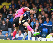 Southend player Noel Hunt shields the ball from Peterborough United player Michael Bostwick during the Sky Bet League 1 match between Southend United and Peterborough United at Roots Hall, Southend, England on 5 September 2015. Photo by Bennett Dean.