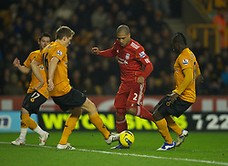 WOLVERHAMPTON, ENGLAND - Tuesday, January 31, 2012: Liverpool's Glen Johnson is fouled by Wolverhampton Wanderers' Emmanuel Frimpong during the Premiership match at Molineux. (Pic by David Rawcliffe/Propaganda)