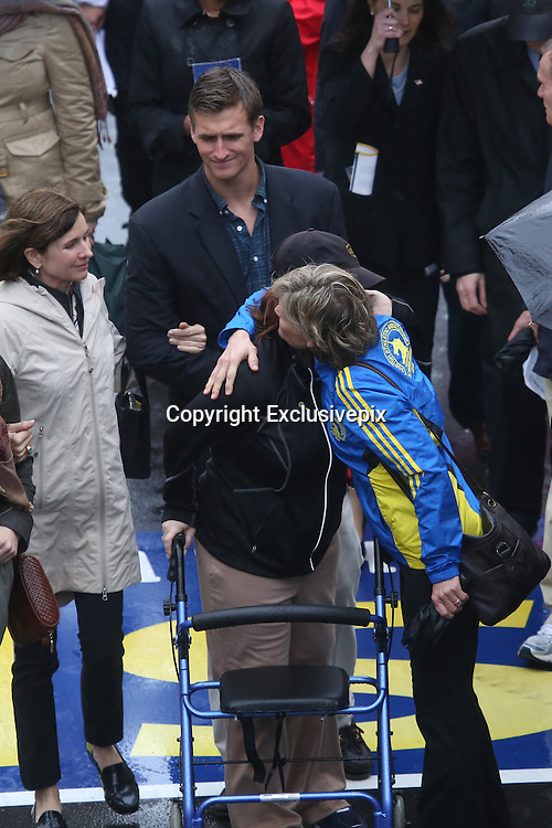 April 14, 2014 - Boston, Massachusetts, USA - <br /> <br /> Boston Marathon Bombing Anniversary<br /> <br /> Hundreds gather at the Boston Marathon finish line in Boston, Massachusetts to mark the one year anniversary of the Boston Marathon Bombing. United States Vice President Joe Biden attended the event. Bombing Survivor Erika Brannock receives a hug from her mother Carol Downing as she crosses the finish line. Erika was injured by the first blast as she was waiting at the finish line to cheer her mother Carol Downing on. <br /> &copy;Exclusivepix