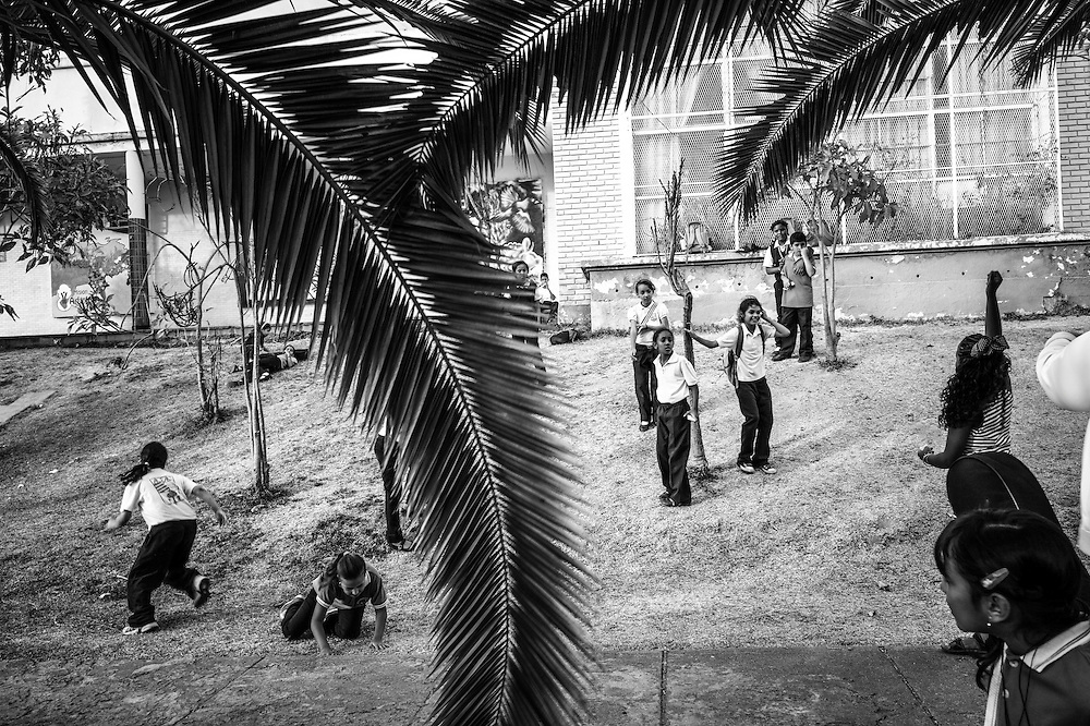 Children play tag outside of the Sarria nucleo, of the El Sistema music program in Sarria, a  dangerous slum in Caracas, Venezuela.