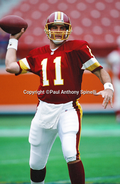 Washington Redskins quarterback Mark Rypien (11) throws a pass while warming up before the NFL football game against the Los Angeles Rams on Nov. 21, 1993 in Anaheim, Calif. The Rams won the game 10-6. (©Paul Anthony Spinelli)