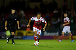 Swindon Defender Louis Thompson (ENG) in action during the first half of the match - Photo mandatory by-line: Rogan Thomson/JMP - Tel: Mobile: 07966 386802 08/10/2013 - SPORT - FOOTBALL - County Ground, Swindon - Swindon Town v Plymouth Argyle - Johnstone Paint Trophy Round 2.