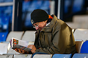 A Luton fan reads the programme before the EFL Sky Bet League 1 match between Luton Town and Burton Albion at Kenilworth Road, Luton, England on 22 December 2018.